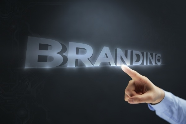 a hand pointing to a graphic of the word branding